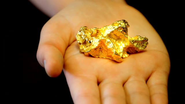 Gold nugget in hand