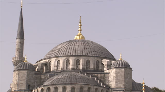 A gold spire tops the beautiful Sultan Ahmed mosque in Istanbul. Available in HD