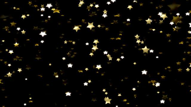 Goldene Sterne fallen