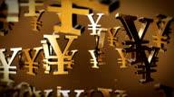 Gold yen symbols scroll across a bronze background.