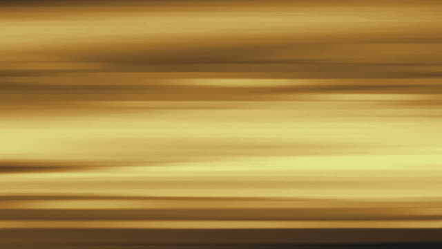 Golden blurs streak and flow (Loop).