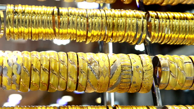 Golden bracelets on window display