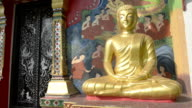 Golden Buddha figure at Wat Klong Prao buddhist temple