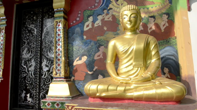 Golden Buddha figure at Wat Klong Prao buddhist temple