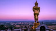 Golden buddha statue standing.(Time Lapse)