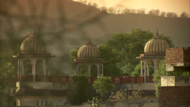Golden light shines on a palace in India. Available in HD