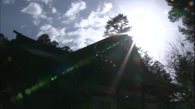 Golden light shines over the Kumano Hongu Taisha Shrine in Tanabe, Japan.