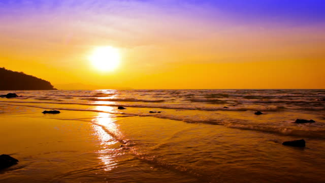 Golden sea wave and sun with reflection
