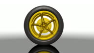 Golden Sports Car Tire Rolling