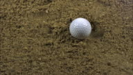 'Golf Ball Falling into Bunker, Golf Near Sciacca in Sicily, Italy, Slow Motion'