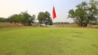 Golf Course Putting Green with flag