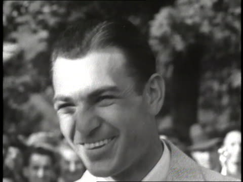 Golfer Ben Hogan smiles at the camera