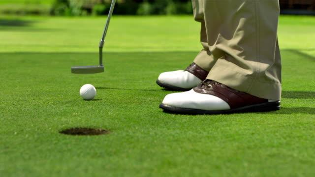 CU LA DS Golfer Holing The Ball