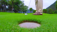 Golfer Putting the Golf Ball