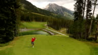 Golfers tee off on mountain course