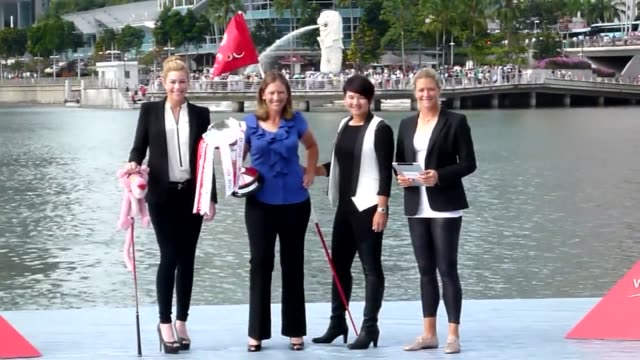 Golfers US players Paula Creamer and Angela Stanford Taiwans Yani Tseng and Norways Suzann Pettersen pose with the trophy at the Marina Bay ahead of...