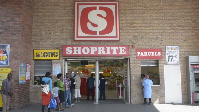 Goods sit on display shelves inside a Shoprite Holdings Ltd supermarket in Alexandra district of Johannesburg South Africa on Monday Aug 17 2015...