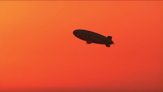 Goodyear Blimp Flying at Sunset over Los Angeles on October 15 2013 in Los Angeles California