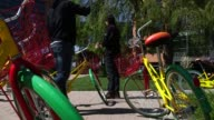 Google colored bicycles at Google Global Headquarters in Mountainview California US on March 26 Close ups of Google colored bicycles outside of a...