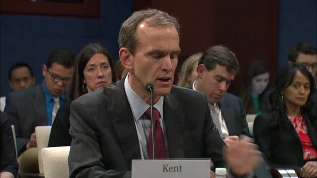Google Vice President And General Counsel Kent Walker reads a prepared statement to the house Intelligence Committee at a hearing on Russian...