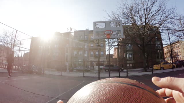 A GoPro shot of an unrecognizable caucasian man missing a free throw in basketball - 4k