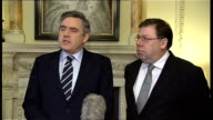 Gordon Brown and Brian Cowen press conference on devolution in Northern Ireland ENGLAND London INT Gordon Brown MP and Brian Cowen entering room...