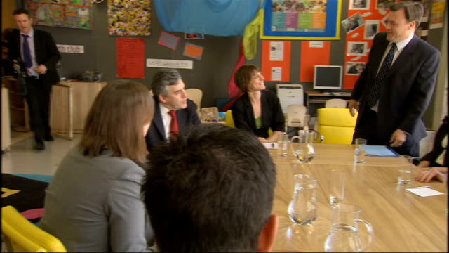 Gordon Brown and Ed Balls visit to Sure Start centre in London INT Brown and Balls taking seats for meeting with Teach First recruits and talking...