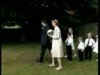 Gordon Brown and wife Sarah walk onto lawn to pose for photos on wedding day Aug 2000
