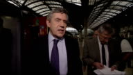 Gordon Brown at Paddington Station ENGLAND London Paddington Station INT Gordon Brown MP along platform greeted by Lord Adonis Gordon Brown interview...