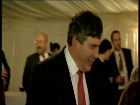 Gordon Brown at social function laughs out loud