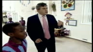 Gordon Brown positive about future of fourmonthold son diagnosed with cystic fibrosis DATE Brown with children throwing rugby ball Child throwing...