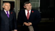 Gordon Brown round table meeting with Northern Ireland political parties EXT Brown and Peter Hain MP wearing red poppies departing Number 11 and...