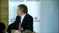 Gordon Brown speech on 'Building Britain's Future' ENGLAND London INT Gordon Brown MP along into room shaking hands with members of audience and...