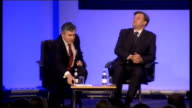Gordon Brown speech on social mobility ENGLAND London Westminster QE2 Centre INT Gordon Brown MP along to stage and takes seat joined by Ed Balls MP...