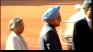 ceremonial guard of honour / laying wreath at Gandhi memorial INDIA New Delhi Rashtrapati Bhawan EXT Indian flag flying on mast / Manmohan Singh...