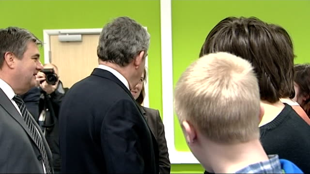 Gordon Brown visit to Great Yarmouth College EXT Brown leaving college with officials Brown and officials entering another building and Brown...