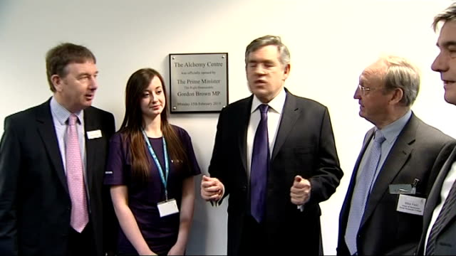 Gordon Brown visit to Great Yarmouth College EXT Brown walking past college buildings with officials Brown with officials in front of plaque ZOOM IN...