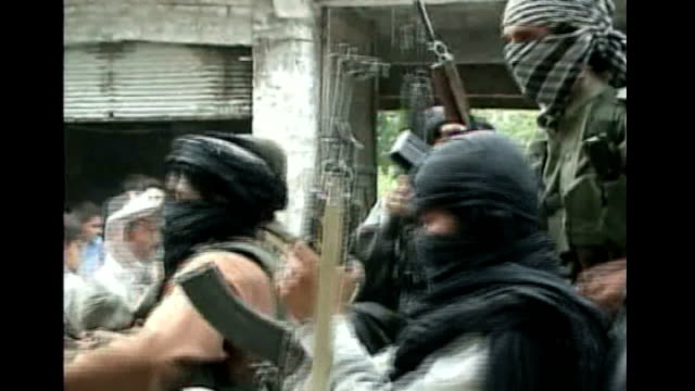 Buner EXT Various of masked and armed Taliban militants