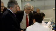 Gordon Brown visits Swansea University Brown along into laboratory with Morgan and others and talking to PhD students working in laboratory SOT...