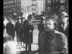 Gov Thomas E Dewey 1948 Republican Party presidential candidate emerges smiling from voting booth / side view US President Harry Truman Democratic...