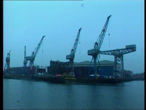 LIB GV LMS Govan shipyard seen across Clyde GV Walkway over river BV Workers along carrying sections of pipe on shoulders