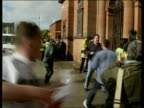 Govan Town Hall MS Man attacks another with stick as Glasgow caught by policeman ZOOM IN MS Police drag away man trying to jump into crowd PAN RL MS...