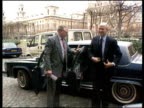 Government angered over Gerry Adams visit to United States EXT Ray Seitz getting out of car and being greeted FREEZE