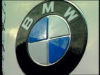 Government money for Rover plant LIB Munich BMW headquarters GV BMW symbol on sign GV BMW sign LA MS tubular towers of BMW LA GV HQ building with...