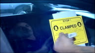 Government plans to make clamping on private land illegal / Wembley standoff T21080946 EXT 'Clamped' sticker affixed to car window Close Shot of...