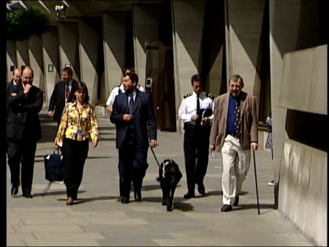 Government plans to reform the justice system Sentencing changes LIB David Blunkett MP towards along street with guide dog Blunkett along street with...