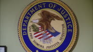 CU ZO Government seal department of justice on interior wall