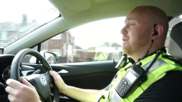 Government suffers defeat over public sector pay ENGLAND Lincolnshire Lincoln EXT Police cars away with lights flashing and sirens sounding Sergeant...