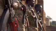Government troops holding rifles and standing to attention in Yei South Sudan