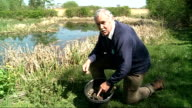Government urged to step up fight against alien species London Wetland Centre Arbon holding brick with some small Zebra Mussels attached Arbon...